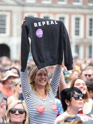 A Yes campaigner celebrates at Dublin Castle (Niall Carson/PA)