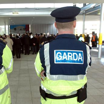 Seven Gardai have been injured after their cars were rammed by a suspected robber