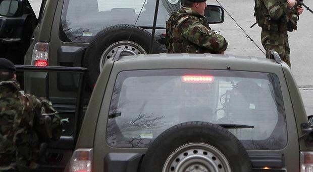A heavy security presence is seen outside the Special Criminal Court in Dublin for the arrival of Wayne Dundon and associate Nathan Killeen. PRESS ASSOCIATION Photo. Picture date: Friday February 22, 2013. Dundon and associate Killeen were brought before the non-jury Special Criminal Court, where they were charged with killing the 34-year-old, whose family have been relocated overseas under witness protection. See PA story COURTS Collins Ireland. Photo credit should read: Niall Carson/PA Wire
