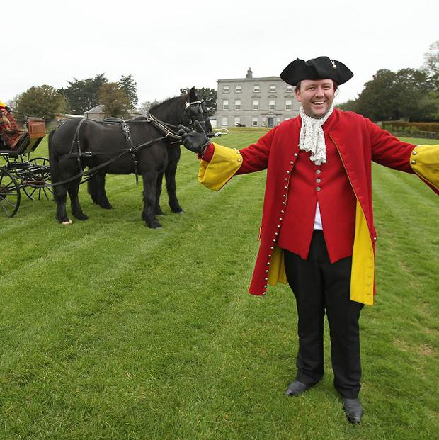 Re-enactor David Mulreany welcomes visiters to site the 1690 Battle of The Boyne near Drogheda
