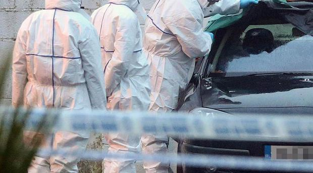 Forensic garda attend the scene where a man has been shot dead in Gormanstown, Co Meath