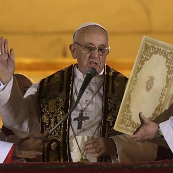 Pope Francis speaks from the central balcony of St Peter's Basilica (AP)