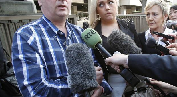 Andrew Furlong, his daughter Andrea and wife Angela speak to reporters outside Tokyo District Court (AP)