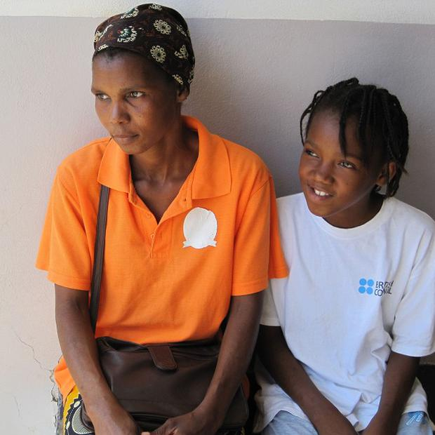 HIV sufferer Felismina Pedro Wmbi Maholela and her ten-year-old daughter Madalena being treated at the busy Polana Canico clinic