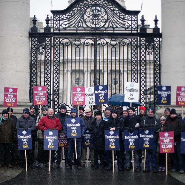 Members of the Garda Representative Association protest outside Government Buildings in Dublin