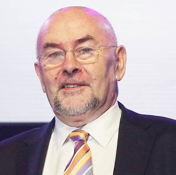 About 100 members of the Irish National Teachers' Organisation repeatedly interrupted Ruairi Quinn's address at a conference
