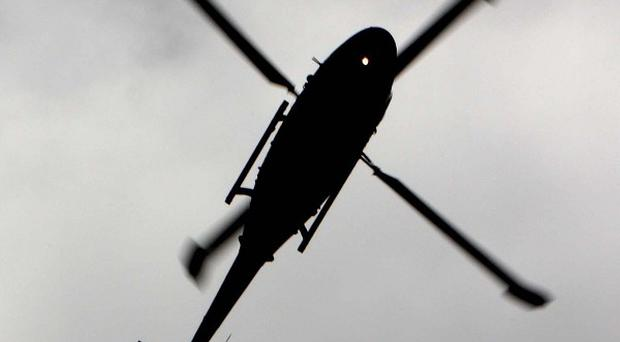 A helicopter was forced to make an emergency landing after its blades got caught in overhead cables