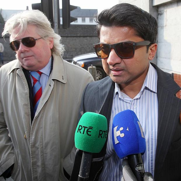 Praveen Halappanavar and his solicitor arrive at Galway Coroner's Court