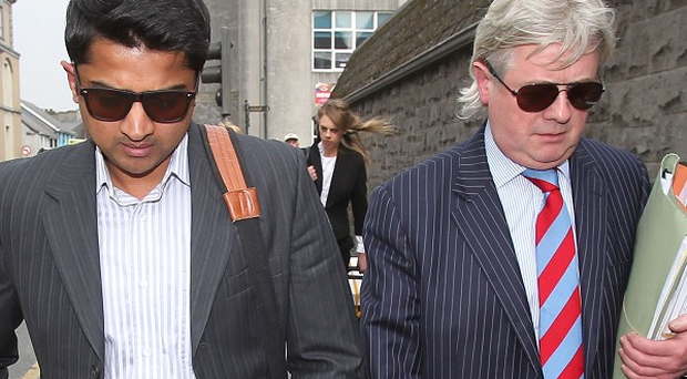 Praveen Halappanavar and his solicitor Gerard O'Donnell leave the inquest into her death