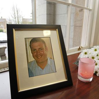 A portrait of Detective Garda Adrian Donohoe in Dundalk Garda Station after he was shot dead