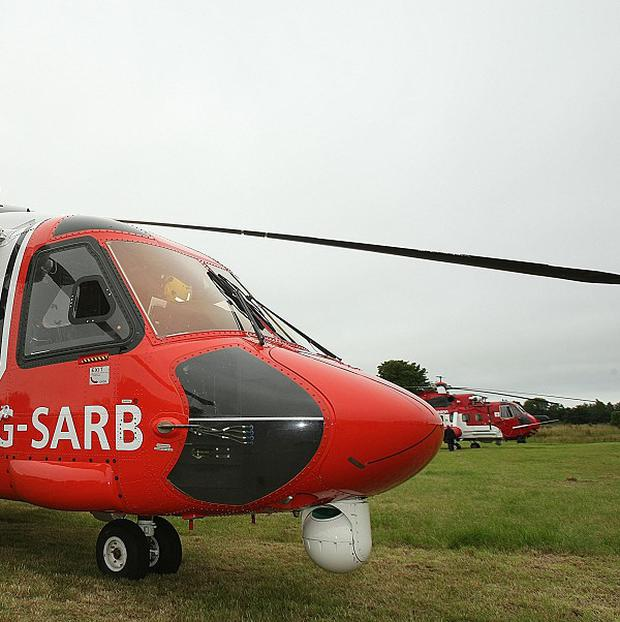 A Coastguard helicopter helped rescue a woman who fell down a mineshaft