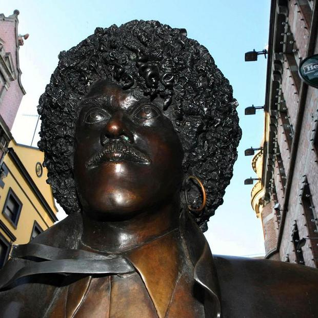 The life-size bronze sculpture of Phil Lynott off Grafton Street has been removed after it was pushed over by vandals