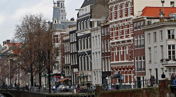 Damien McFadden, 37, is believed to have died after falling into the Singel Canal in Amsterdam