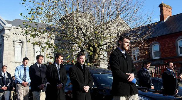 Members of the Garryowen Rugby club form the Guard of Honour at the funeral of rugby player Shane Geoghegan