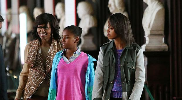 US First Lady Michelle Obama with her daughters Sasha and Malia Ann during their visit to the Long Room in Trinity, Dublin