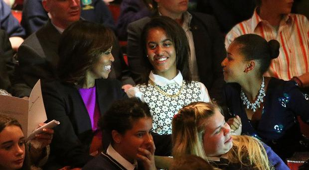 US First Lady Michelle Obama has visited the Wicklow Mountains National Park with her daughters Malia (centre) and Sasha