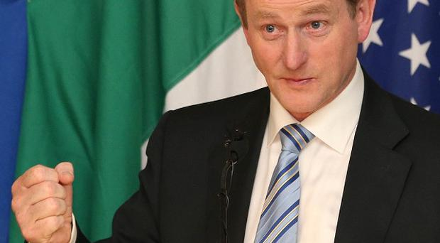 Taoiseach Enda Kenny said he understood how angry ordinary people felt about taped conversations of former Anglo Irish bankers