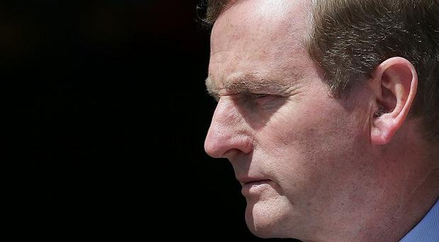 Taoiseach Enda Kenny has faced calls from campaigners about new abortion laws