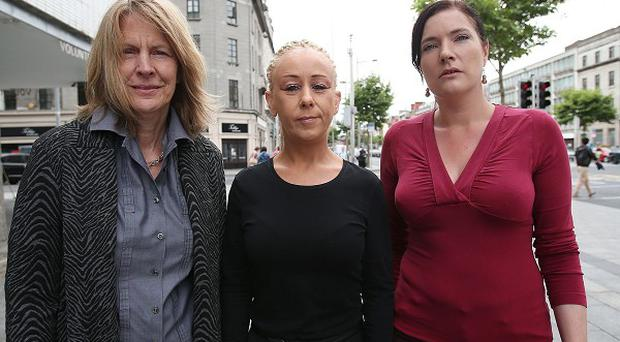 Cherie Jimenez, Justine Reilly and Rachel Moran, left to right, at the press conference by SPACE International