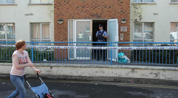 Gardai at the scene at the scene of a fire at an apartment complex in Watery Lane, Clondalkin
