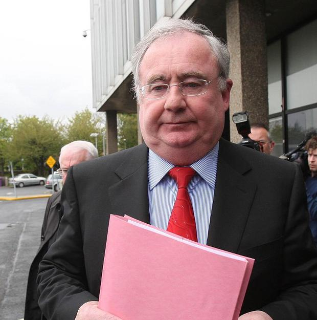 Communications Minister Pat Rabbitte was confronted by protesters outside a Dublin pub