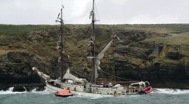 The listing Astrid is battered against rocks on the Cork coast