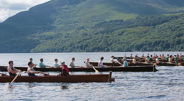 Oxford and Cambridge Boat Clubs race with six other local teams in The Killarney Rowing Festival