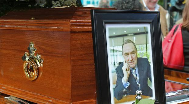 A portrait of RTE presenter Colm Murray rests on his coffin at his funeral at St Gabriels Church in Dollymount, Dublin
