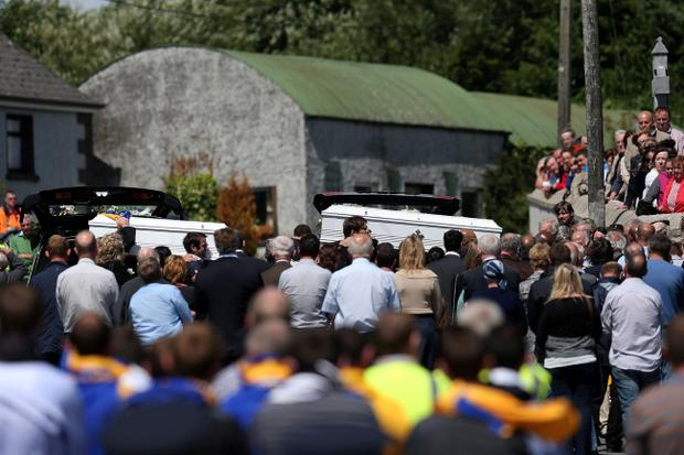 The funeral procession of brothers Eoghan, 10 and Ruairi Chada, five, makes its way to St Lazerian's church in Ballinkillen, County Carlow