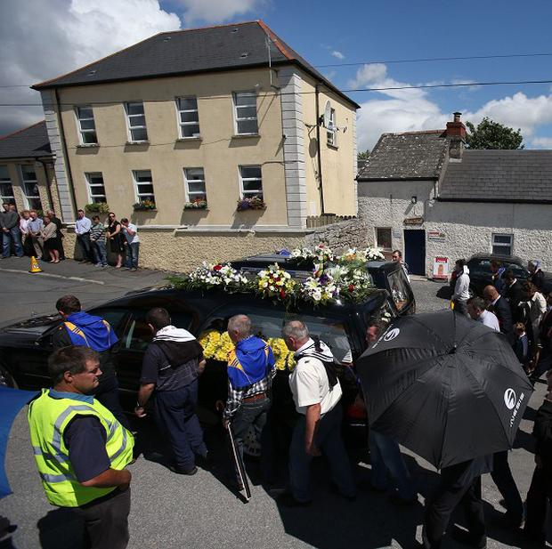 The funeral procession of Eoghan, 10, and Ruairi Chada, five, makes its way to St Lazerian's church in Ballinkillen, Co Carlow