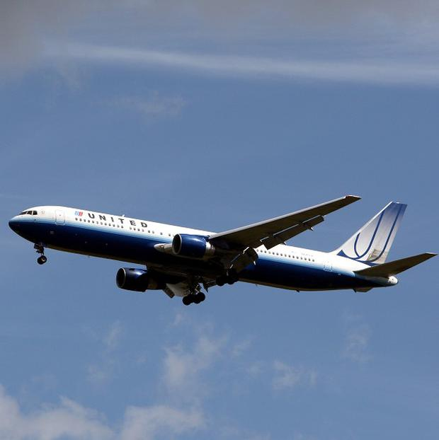 Customers who rushed to 'buy' airline tickets for $0 when the United Airlines website was hit with a technical glitch are waiting to find out if the company will honour their tickets.