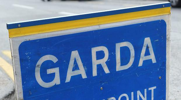 A garda sergeant suffered cuts and bruises when a car ploughed into him as he investigated a traffic collision