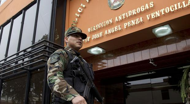A police officer walks past the Peruvian police anti-drug headquarters where Michaella McCollum Connolly and Melissa Reid are being held (AP)