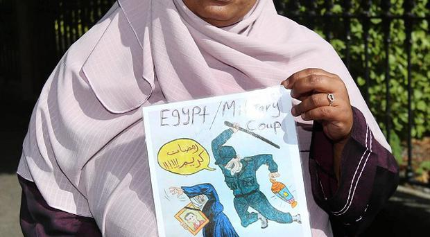 Nosaybe Halawa joins a protest at the Egyptian embassy in Dublin calling for the release of her siblings from custody
