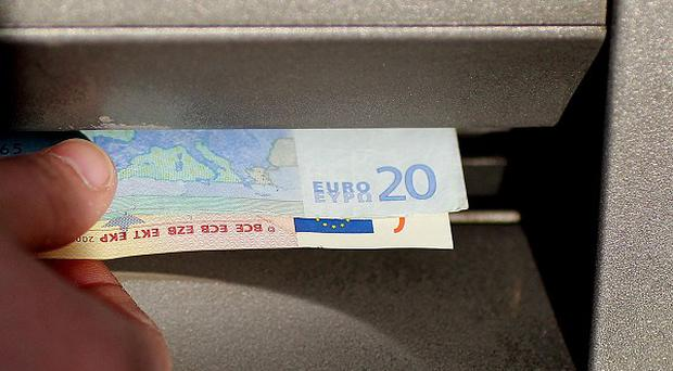 A pair of Garda officers have been arrested in connection with an alleged cash machine scam