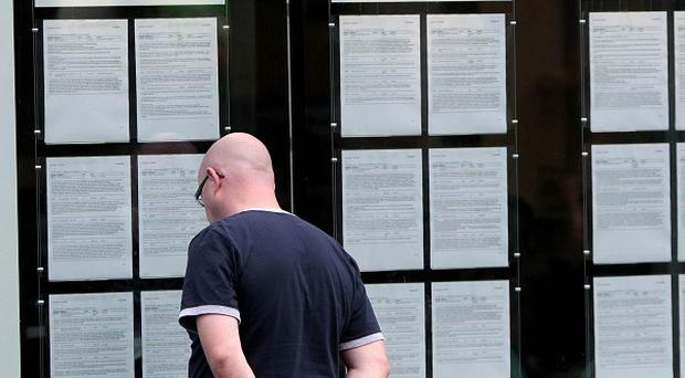 A report on the job market found the number of people out of work fell by 22,000 in the year to the end of June