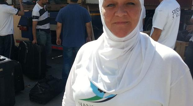 Iman Mujahed, trustee of Hand in Hand for Syria, at an aid drop for the public to bring supplies which will be transported to Syria