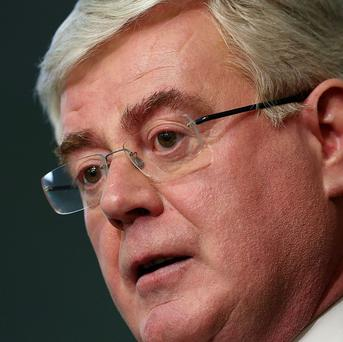 Tanaiste Eamon Gilmore has claimed the Government should do 'no more than is necessary' in terms of austerity