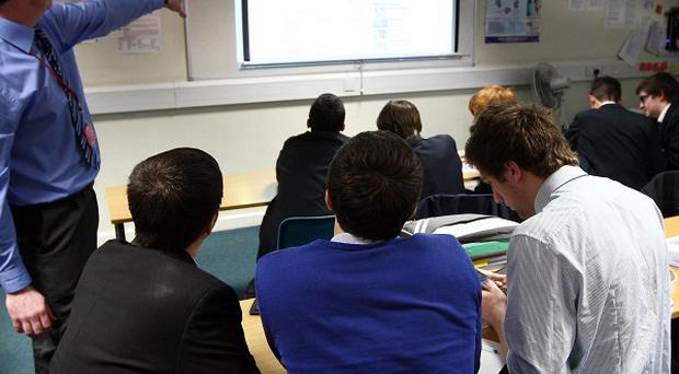 School principals and a teaching union have clashed over plans for industrial action in a pay dispute