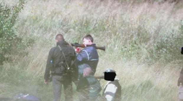 A Lithuanian police surveillance picture of Michael Campbell testing weapons (AP)