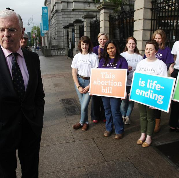 TD Peter Mathews, who has resigned from Fine Gael, leaving Leinster House in Dublin after voting against the protection of Life during pregnancy bill.