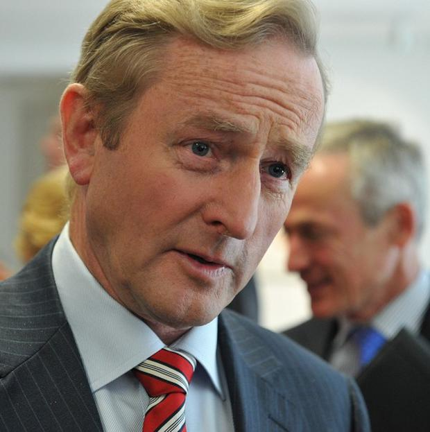 Taoiseach Enda Kenny has announced the Republic will make a clean exit from the bailout