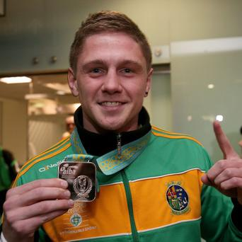 Silver medalist Jason Quigley in Dublin Airport as the Irish elite boxing squad arrive home from the AIBA World Elite Men's Championships in Almaty, Kazakhstan.