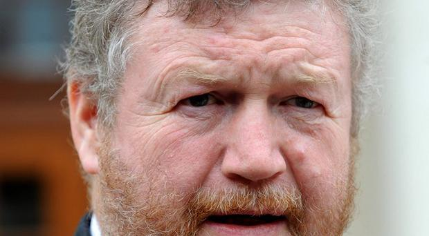 The Minister for Health, Dr James Reilly, says no-one entitled to a medical card will lose one.