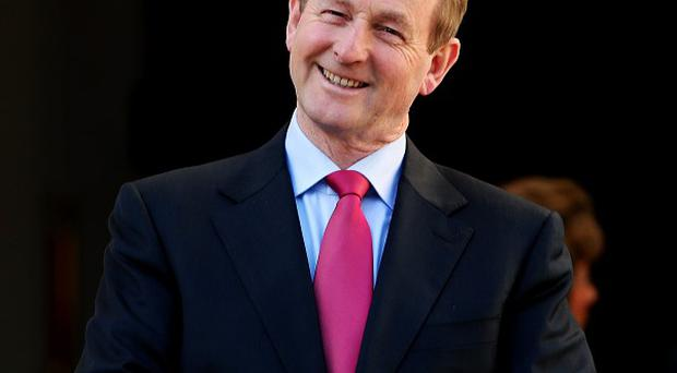 Taoiseach Enda Kenny TD awaits the arrival of Italian prime minister Enrico Letta at Government Buildings, Dublin.