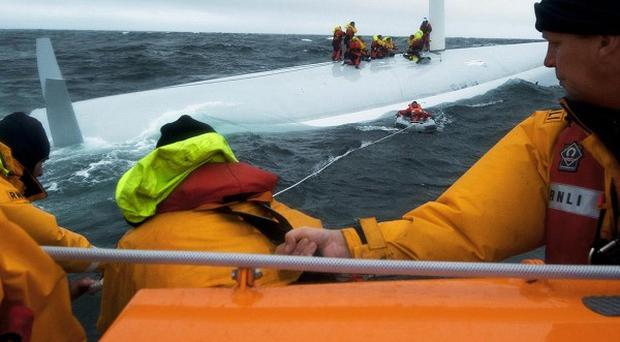 The Baltimore RNLI lifeboat crew taking part in a major rescue operation when a yacht capsized during the famous Fastnet race