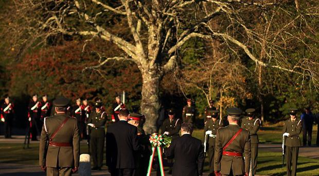 A wreath is laid during a ceremony marking the 50th anniversary of the death of former US president John F Kennedy