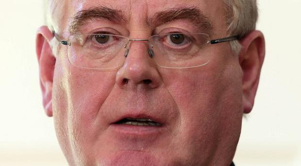Eamon Gilmore says there is still further to go to make economic recovery real in the lives of ordinary people.