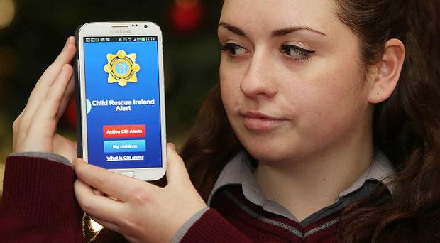Josie McGrath, 17, from Davis College, Mallow, showing the new app that alerts users when a child has been abducted
