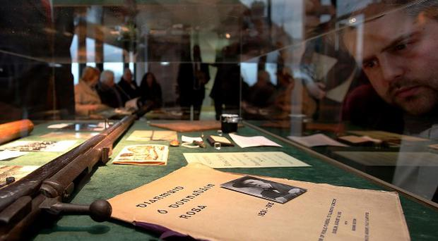 Peter Kavanagh of Active Retirement Ireland views exhibition pieces including a German Mauser rifle